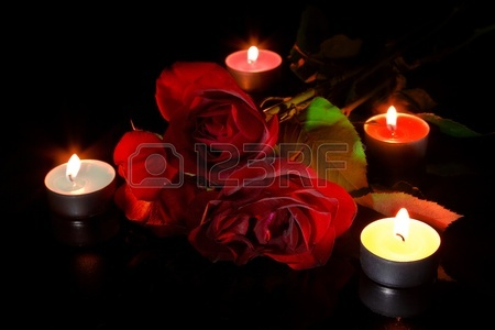 9281327-red-roses-with-candles-on-black